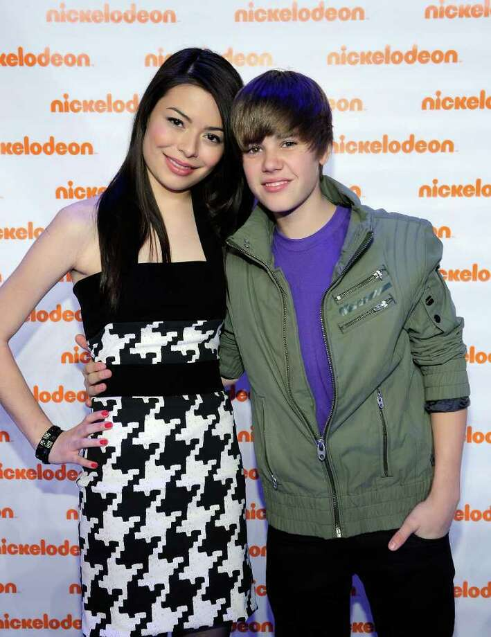 Actress Miranda Cosgrove and musician Justin Bieber attend the Nickelodeon 2010 Upfront Presentation at Hammerstein Ballroom on March 11, 2010 in New York City.  (Photo by Larry Busacca/Getty Images for Nickelodeon) Photo: Larry Busacca / 2010 Getty Images
