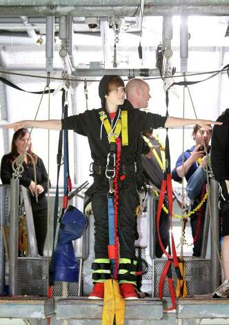 Canadian Pop star Justin Bieber takes part in a bungy jump at Auckland Bridge Bungy, Westhaven Marina during his one day visit to New Zealand on April 28, 2010 in Auckland, New Zealand.  (Photo by Sandra Mu/Getty Images for Tourism NZ) Photo: Sandra Mu / 2010 Tourism NZ