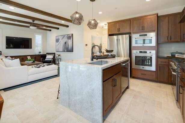 Residences built in DeNova Homes' Mockingbird Lane development in Sonoma feature gourmet kitchens with Bertazzoni ranges and quartz countertops.