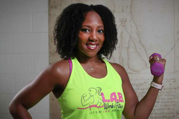 Shenese Colwell uses her barre as a fitness trainer Wednesday, July 8, 2020, in Cypress.