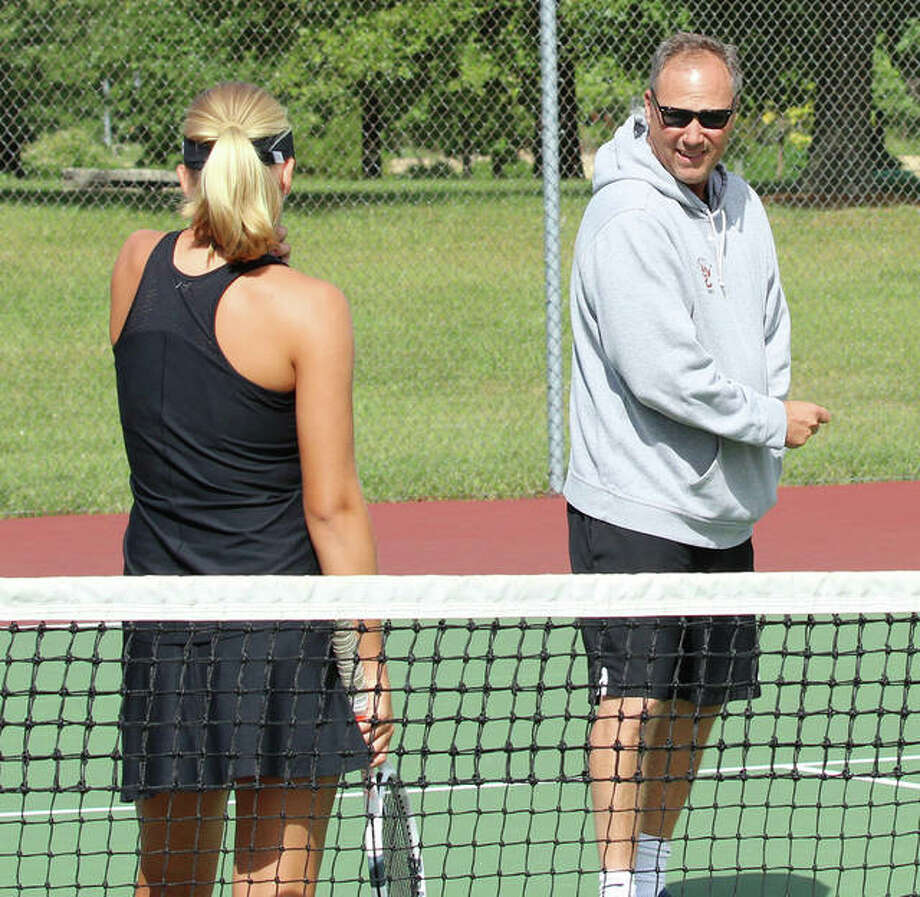 Edwardsville girls tennis coach Dave Lipe, right, talks to Hannah Colbert during a match in 2018. Photo: Intelligencer Sports Staff