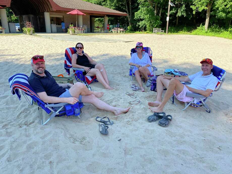 Llsa Tillman, Jan Aalto, Rosie Forrest, and Colin Forrest recently relax under the new shade umbrellas at the beach at New Canaan's Kiwanis Park. The writer of this opinion piece explains why residents of the town should buy a Family Beach Pass for using the park, especially during this summer season. She also puts a scene into perspective when persuading the residents of the town, and any of their guests to visit the park when the residents buy the pass from the town, and can then bring any of the guests they have for free, as the pass makes the cost of the guests, and seniors age 62, and older free. Seniors only need to obtain a beach pass. The beach passes are included in a pool pass. Photo: Contributed Photo
