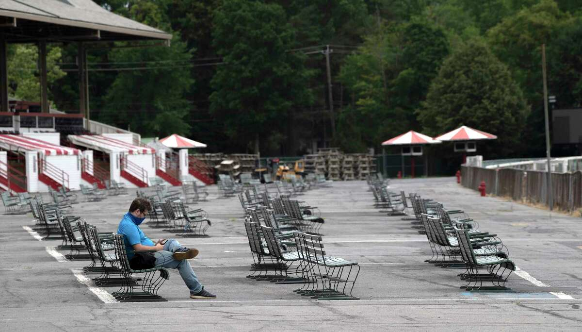 A media member is the only one using the benches on the apron in front of the grandstand on opening day at the Saratoga Race Course July 16, 2020 in Saratoga Springs, N.Y. Photo by Skip Dickstein/Special to the Times Union.