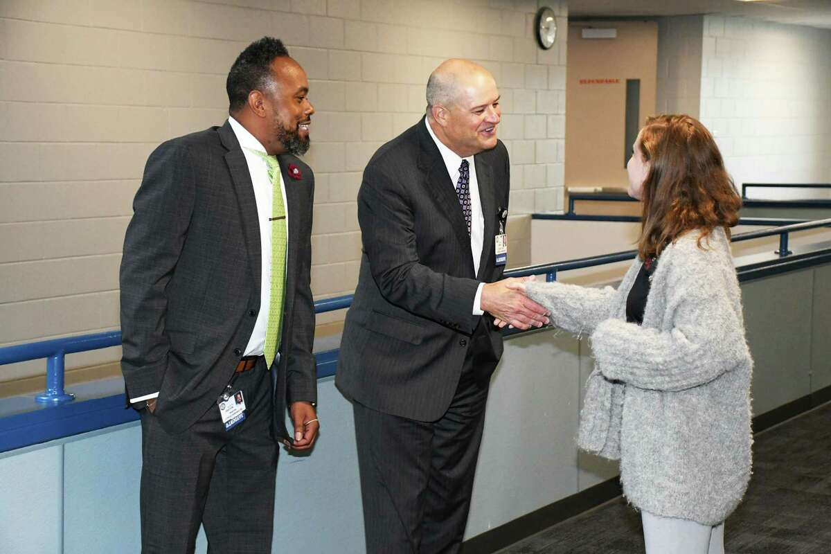 Undated file photo shows Cy-Fair ISD Superintendent Mark Henry and Cook Middle School Principal Martin Drayton meeting some faculty members at the school.