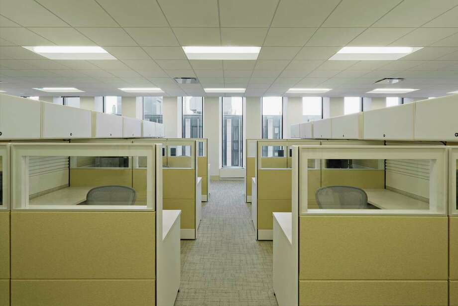 Vacant work spaces separated into cubicle workstations Photo: Getty Images / Corbis Documentary RF