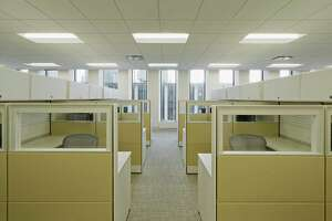Vacant work spaces separated into cubicle workstations