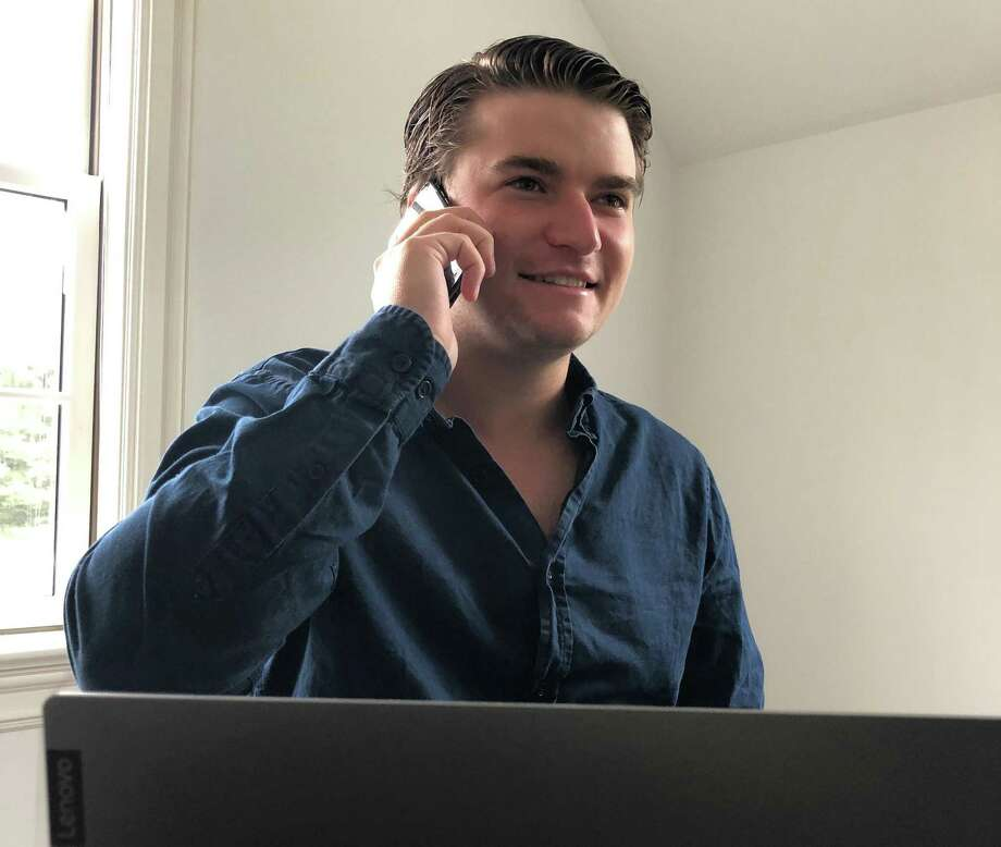 What started out as an internship turned into volunteerism as college student James Mannix makes weekly calls to 15 older adults who are clients of Family & Children's Agency. Photo: Contributed Photo / Family & Children's Agency / Wilton Bulletin
