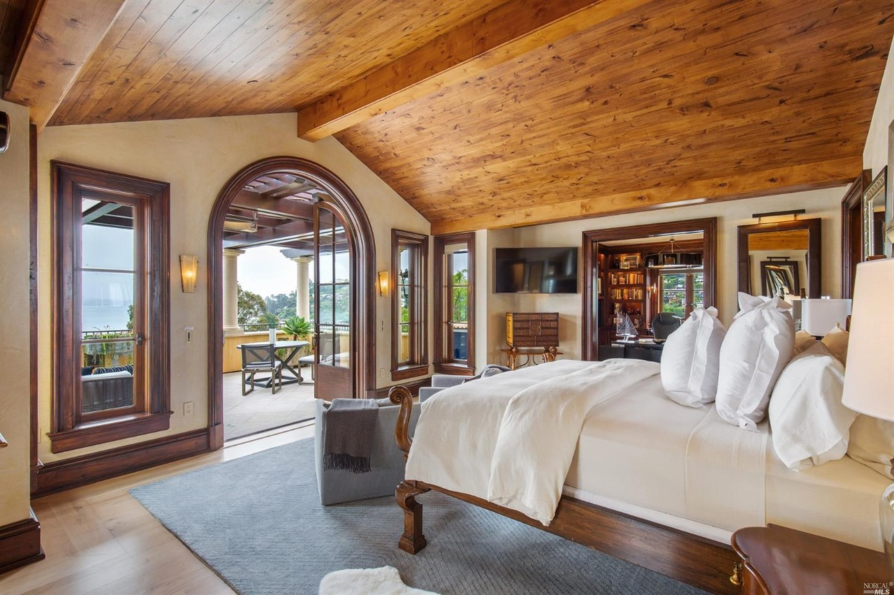 The premiere bedroom suite takes up the majority of the upper floor and has a huge walk out terrace. Three more bedrooms and a family room are one level below the entertaining floor.