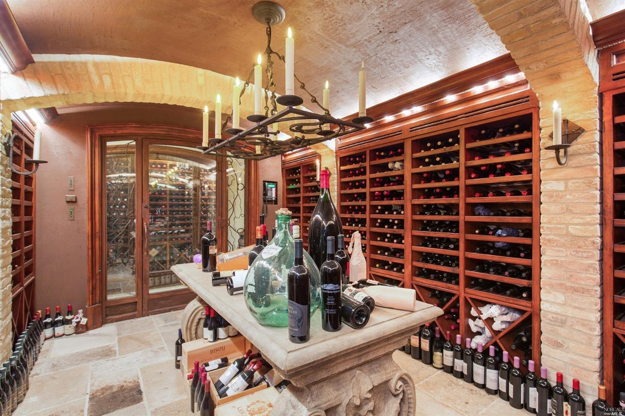 There's also a dine-in wine cellar, one of two on the lowest level, just off the three-car garage.