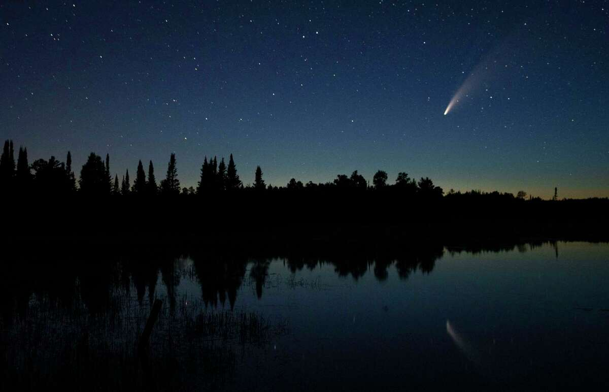 To spot Comet NEOWISE, look to the northwest just above the horizon and just below the Big Dipper constellation. Use a smartphone app like SkyView to help you identify the Big Dipper. Each night, the comet will continue rising increasingly higher above the northwestern horizon.