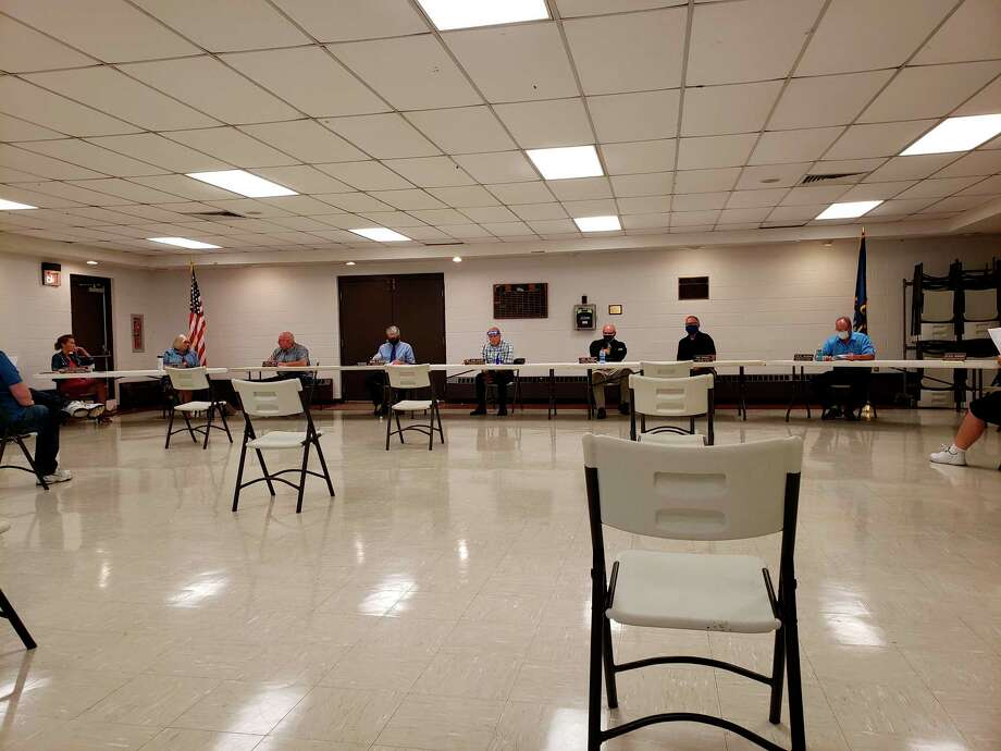 The Huron County Commissioners before this week's meeting at the Huron County Expo Center. The meeting was held there so people could observe social distancing and on Thursday due to scheduling conflicts. (Robert Creenan/Huron Daily Tribune)