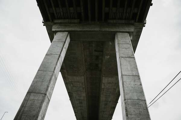 Wide angle shots from underneath an overpass of the West Seattle Bridge in Washington state, USA. The bridge is closed for the foreseeable future due to cracks in the structure, making it unsafe for vehicle traffic.