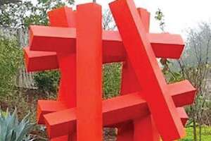 """Alejandro Martin's 2019 painted metal sculpture """"Hashtag-Orange"""" has been added to the McNay Art Museum's collection. It will be displayed on the grounds beginning in August."""