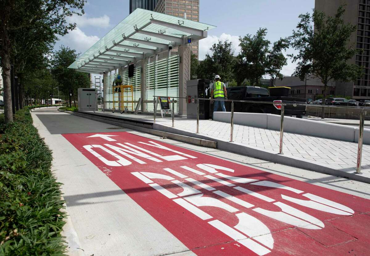 Electricians install a sign at a bus rapid transit platform at the intersection of Post Oak Blvd and Westheimer Road on July 1, 2020, in Uptown. Service on the Silver Line begins Aug. 23, officials said.