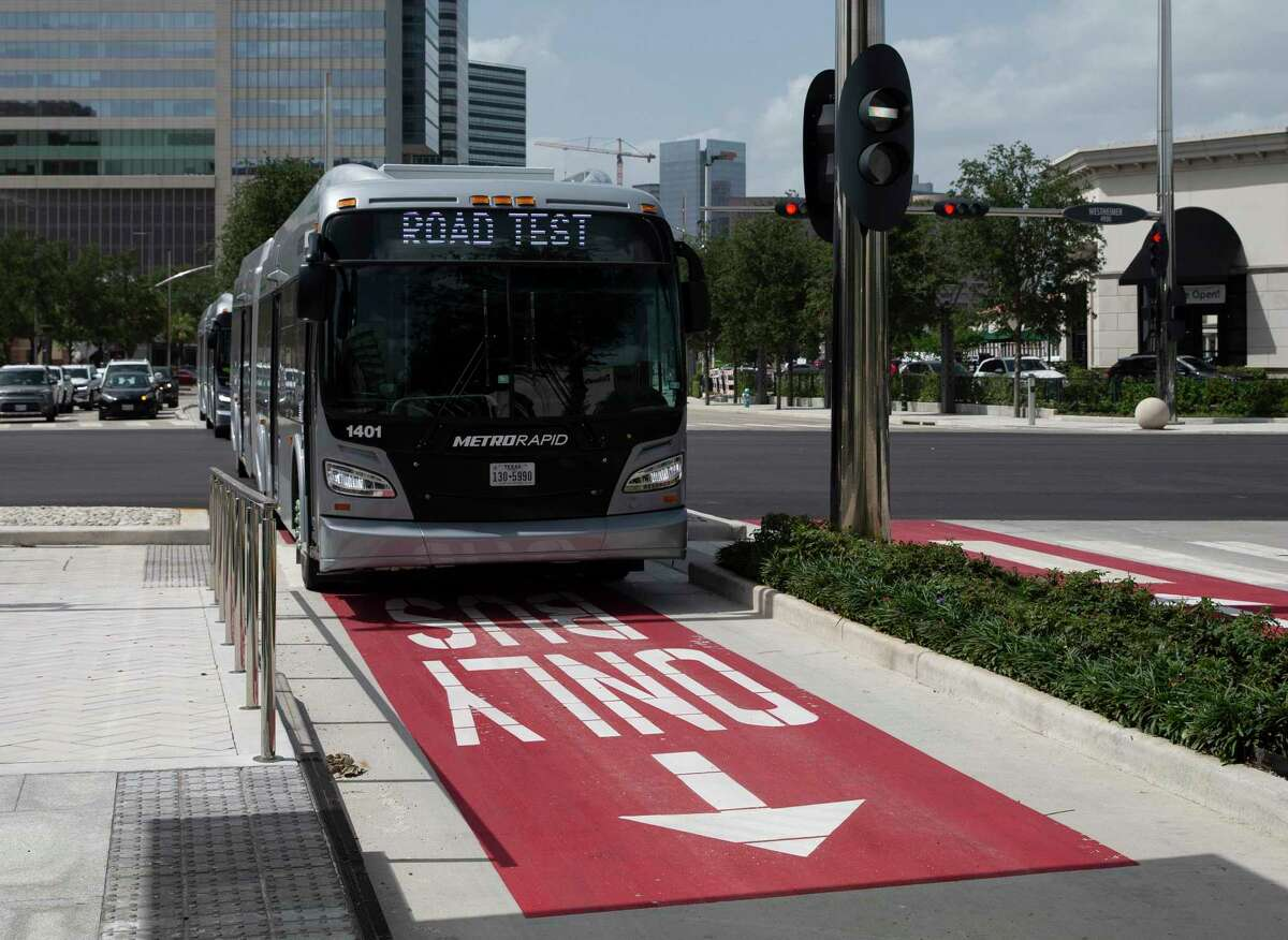 One of 14 60-foot buses operating along the new Silver Line bus rapid transit passes southbound through the intersection of Post Oak Blvd and Westheimer Road on July 1, 2020, in Uptown. Service on the Silver Line begins Aug. 23, officials said.