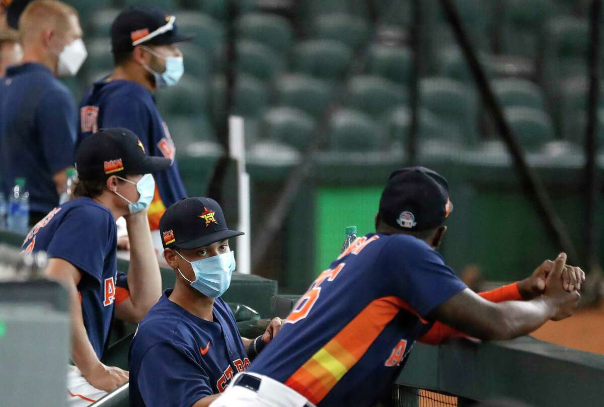 Houston Astros infielder Taylor Jones hangs out in the dugout during the Astros summer camp at Minute Maid Park, Thursday, July 16, 2020, in Houston.