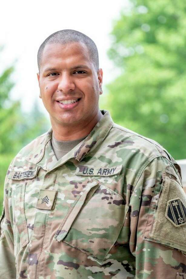 U.S. Army Sgt. Kyle Batosiewicz of Task Force 46, and a native of Manistee, poses for a portrait in East Lansing on June 15, 2020. Task Force 46 is U.S. Army North's flexible, adaptable headquarters responsible for supporting Department of Defense COVID-19 efforts, and providing command and control over DoD military assets as part of Defense Support of Civil Authorities in the event of an all hazards event or a chemical, biological, radiological and nuclear incident in the homeland. (Cpl. Samantha Hall/U.S. Army)