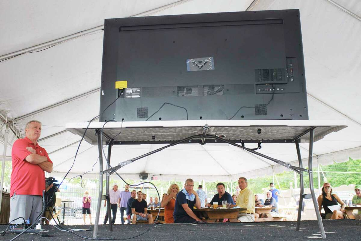 People watch the first race at the Saratoga Race Course on a large screen television at the Horseshoe Inn Bar and Grill, just across from the track on Thursday, July 16, 2020, in Saratoga Springs, N.Y. (Paul Buckowski/Times Union)