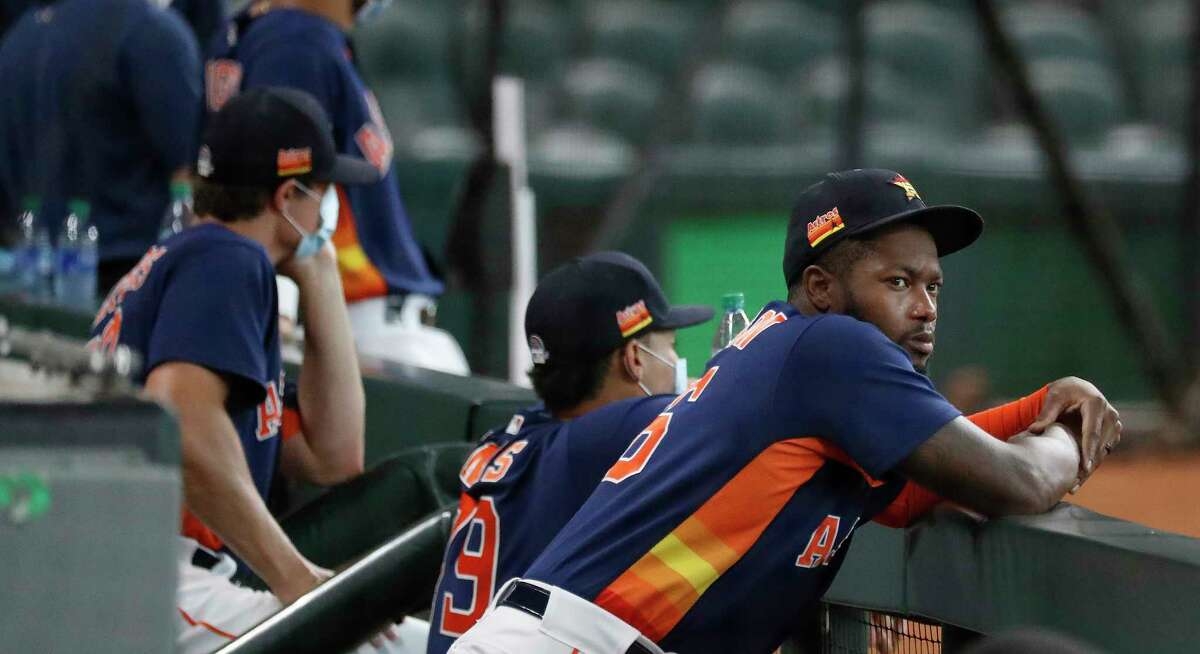 Houston Astros outfielder Ronnie Dawson hangs out in the dugout during the Astros summer camp at Minute Maid Park, Thursday, July 16, 2020, in Houston.
