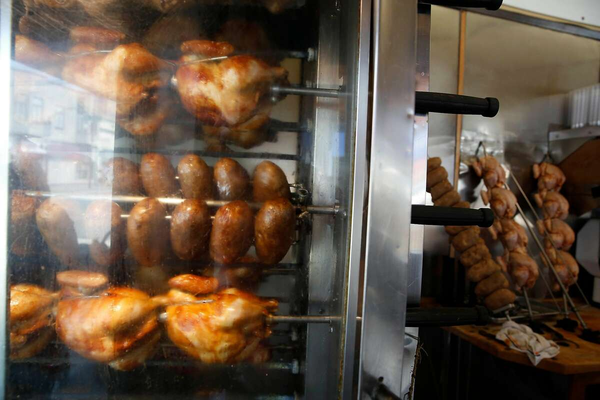 The rotisserie spinning chicken and potatoes is seen at Pete's Bar-B-Que on Mission Street on Wednesday, July 15, 2020 in San Francisco, Calif.
