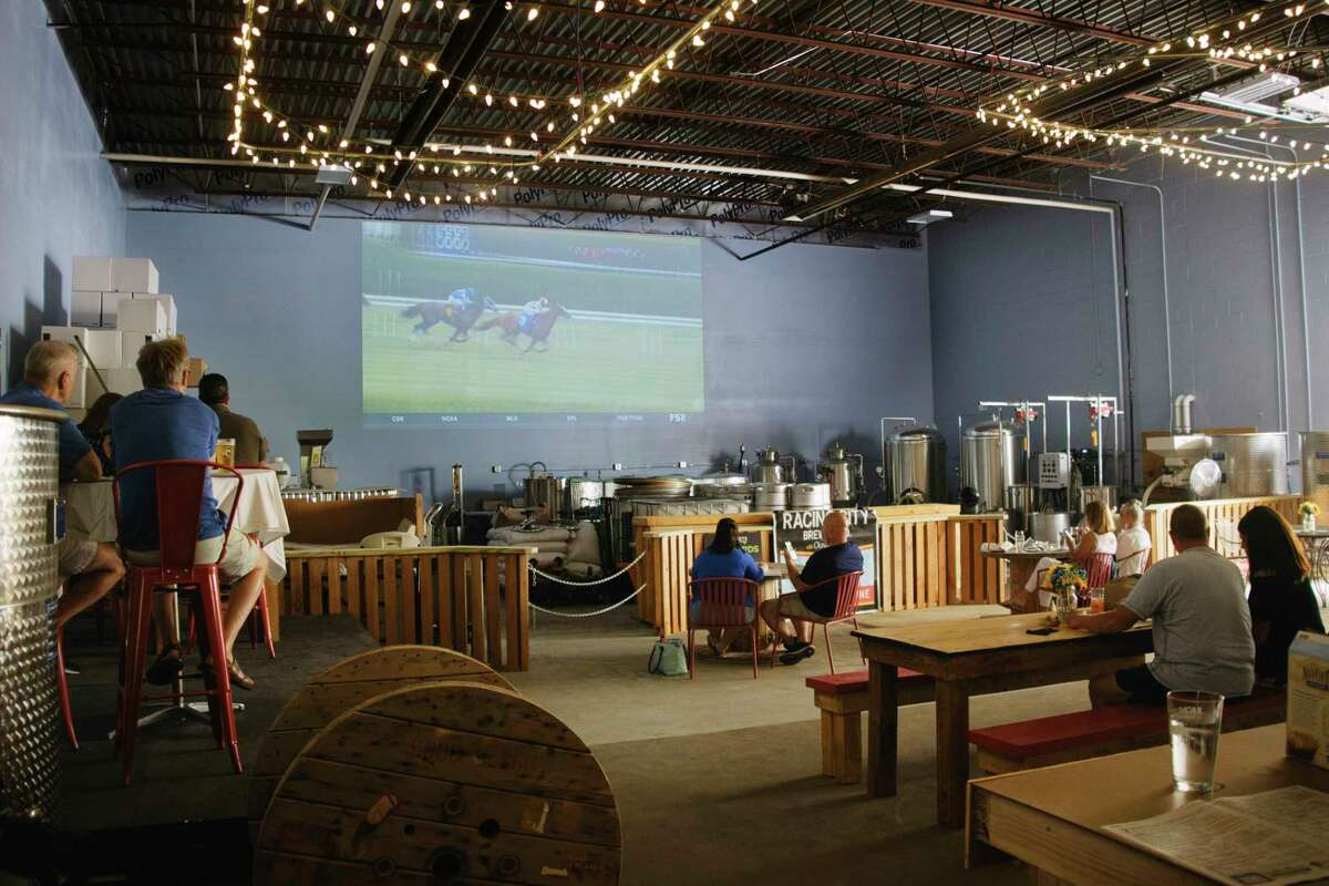 People gather to watch races from Saratoga Race Course at Racing City brewing Company on Thursday, July 16, 2020, in Saratoga Springs, N.Y. (Paul Buckowski/Times Union)
