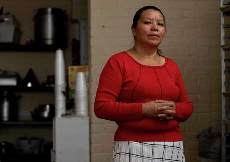 Maria Sarat poses for a photograph inside her apartment  Thursday, July 16, 2020, in Houston. Her brother, Alfonso Sarat, is in the ICU at the Memorial Hermann Southwest Hospital with COVID-19.