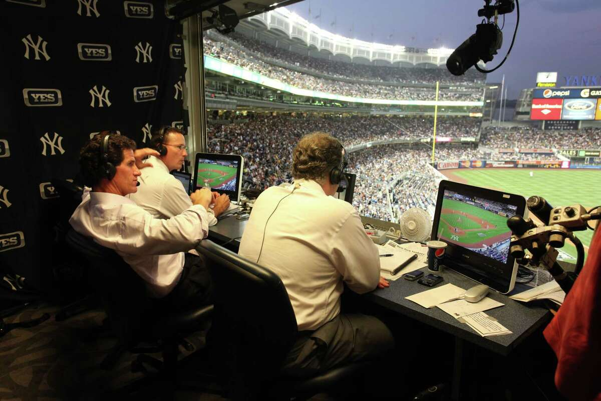 John Flaherty, Paul O?Neill and Michael Kay (left to right) in YES broadcast booth at Stadium.
