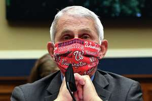 Dr. Anthony Fauci, director of the National Institute of Allergy and Infectious Diseases, wearing a Washington Nationals face mask, testifies at a hearing of the U.S. House Committee on Energy and Commerce on Capitol Hill on June 23. A recent Quinnipiac poll found that 65 percent of the public trust information Fauci gives on the coronavirus pandemic, while only 30 percent trust President Trump's information.