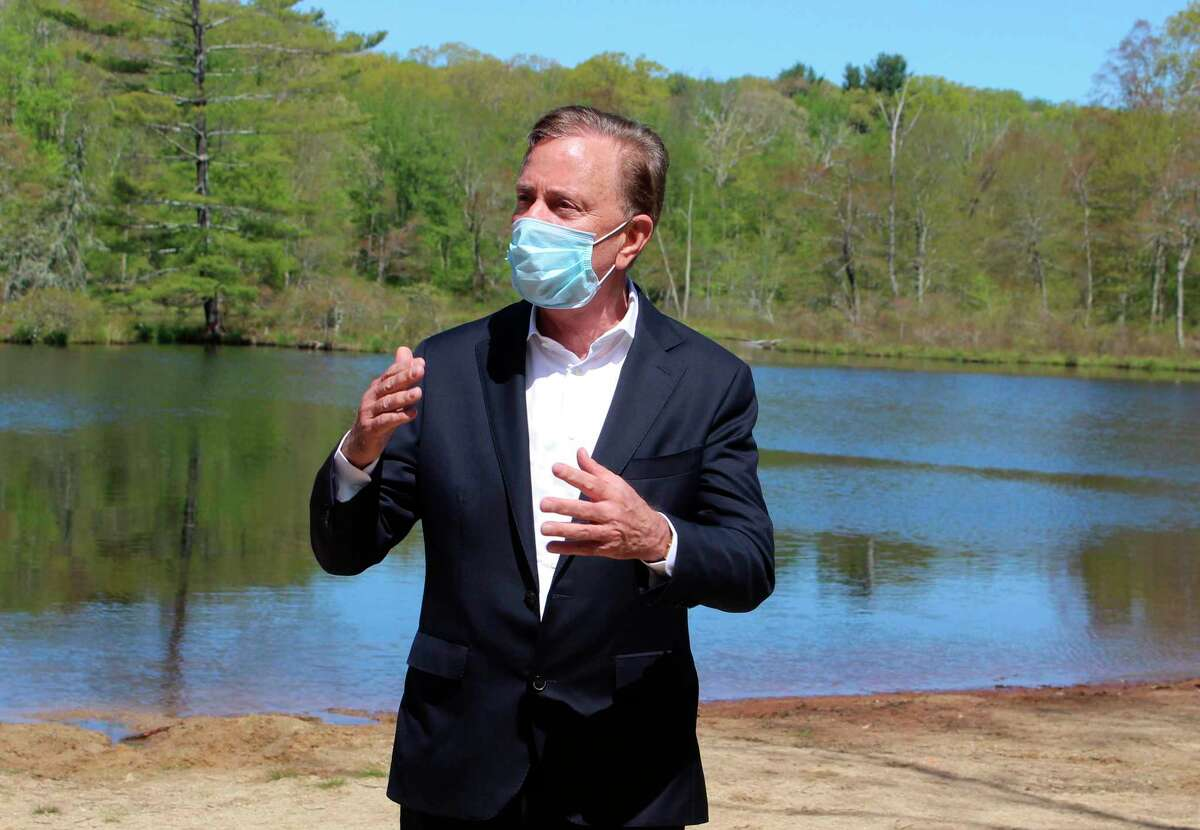 Gov. Ned Lamont speaks to reporters at Gay City State Park in Hebron May 21 as he updates the coronavirus situation in the state. Generally Lamont's daily updates are conducting virtually.