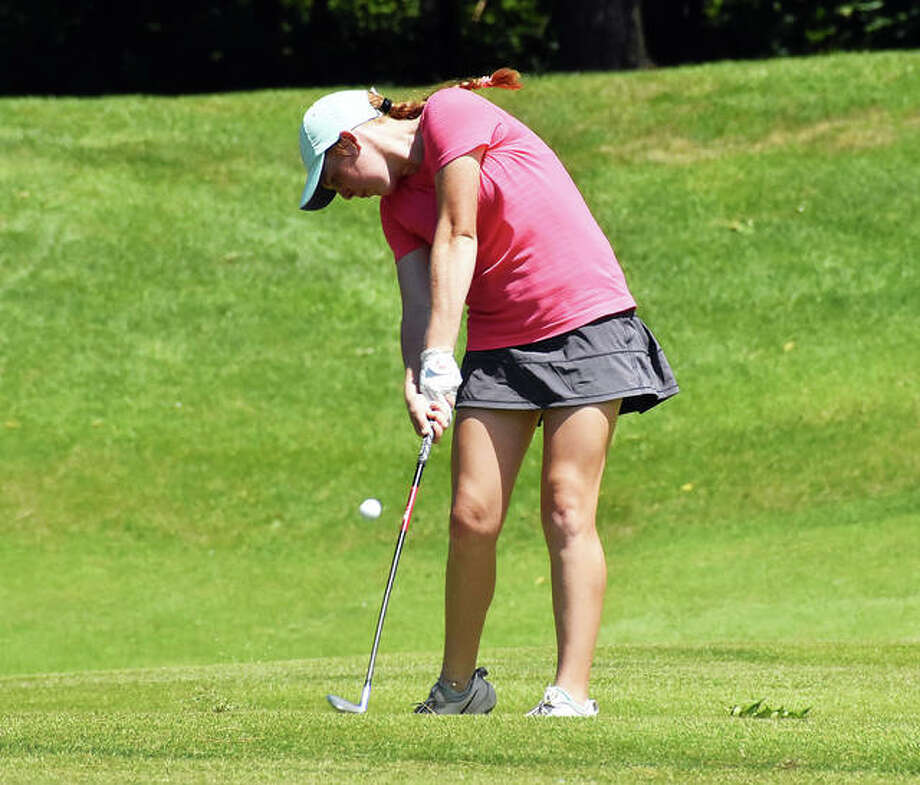 Riley Lewis hits her approach shot on to the green on the 14th hole at Spencer T. Olin Golf Course on Thursday.