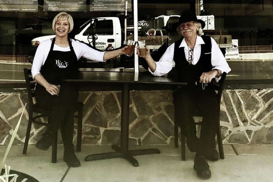Lora Dobbs and Chris LeGate outside Nic's restaurant in Paradise, Calif. Photo: Courtesy Nic's