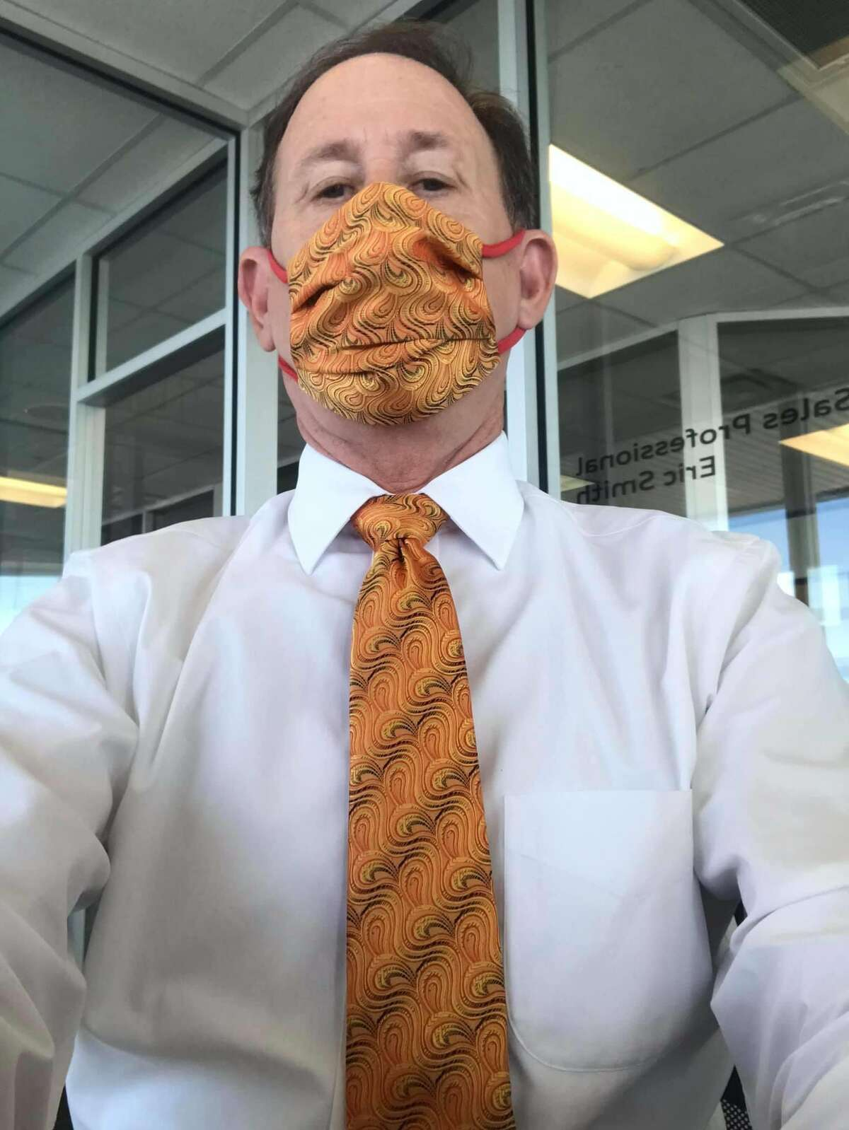 A San Antonio dad has gone viral on Twitter for his stylish ways after turning his pocket inserts into a face mask to match his work tie.