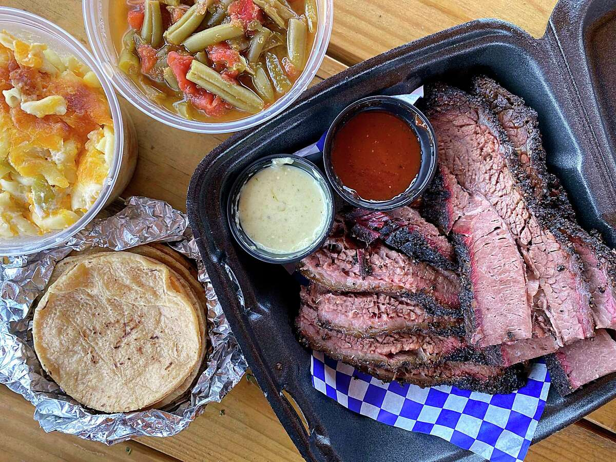 The menu at Holy Smoke Barbecue + Taquitos includes brisket, smoked macaroni and cheese, stewed green beans, tortillas, salsa and barbecue sauce.