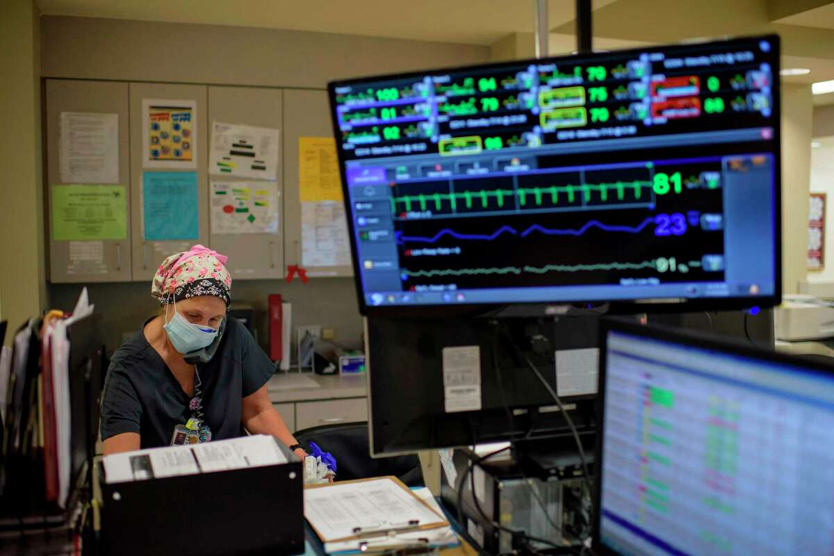 A healthcare worker answers the phone in the ER at Oakbend Medical Center in Richmond, Texas, on July 15, 2020.