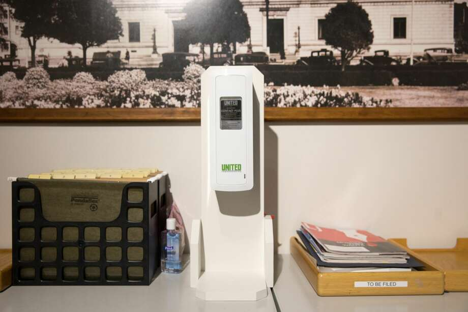 A hand sanitizer dispenser is located in the executive offices of the San Francisco Main Library. Photo: Douglas Zimmerman/SFGATE / SFGATE