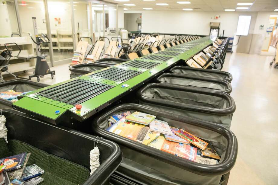 The new Automatic Materials Handling System (AMHS) that was installed to handle books returns at the San Francisco Main Library. It was installed during the shutdown because of the COVID-19 coronavirus. Photo: Douglas Zimmerman/SFGATE / SFGATE