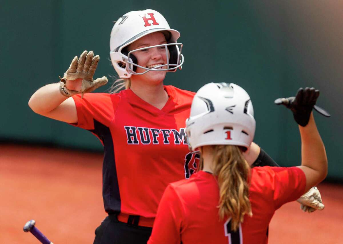 Huffman Hargrave runner Kenzie Gates (15) celebrates scoring against Anna with Alli Humphries (1) during the UIL Class 4A state softball championship in Austin, Saturday, June 1, 2019. (Stephen Spillman / for Houston Chronicle)