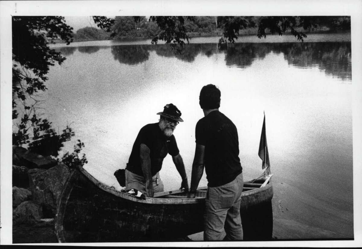 Ernest C. Friedow of Schenectady and Steve Miller launch their canoe preparing for the trip down the Mohawk River from the Stockade. July 17, 1986 (Fred McKinney/Times Union Archive)