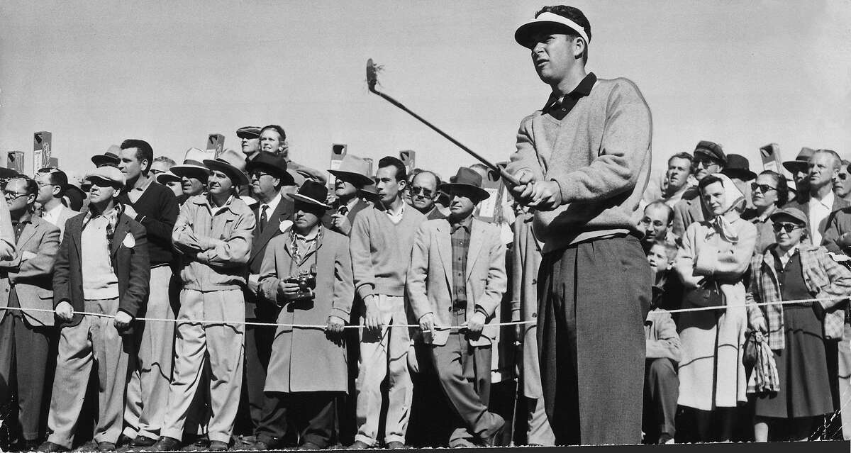 Determined Ken Venturi, surrounded by a straining gallery, on his way to victory. The 24-year-old San Franciscan punched this one to the green on the 24th hole yesterday in beating Harvie Ward 5 and 4. 1956 San Francisco City Golf Championships Photo was taken: 03/11/1956.