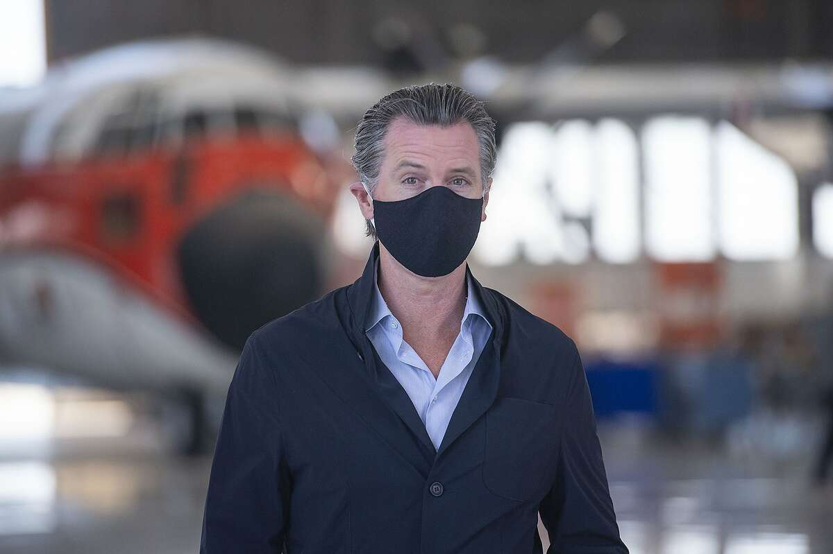 California Gov. Gavin Newsom visits the Cal Fire McClellan Reload Base in Sacramento, Calif., Thursday, July 9, 2020, to discuss the state's new efforts to protect emergency personnel and evacuees from COVID-19 during wildfires. (AP Photo/Hector Amezcua, Pool)