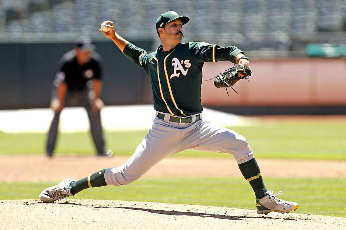 Oakland Athletics' Daniel Mengden pitches during simulated game at Oakland Coliseum in Oakland, Calif., on Sunday, July 12, 2020.
