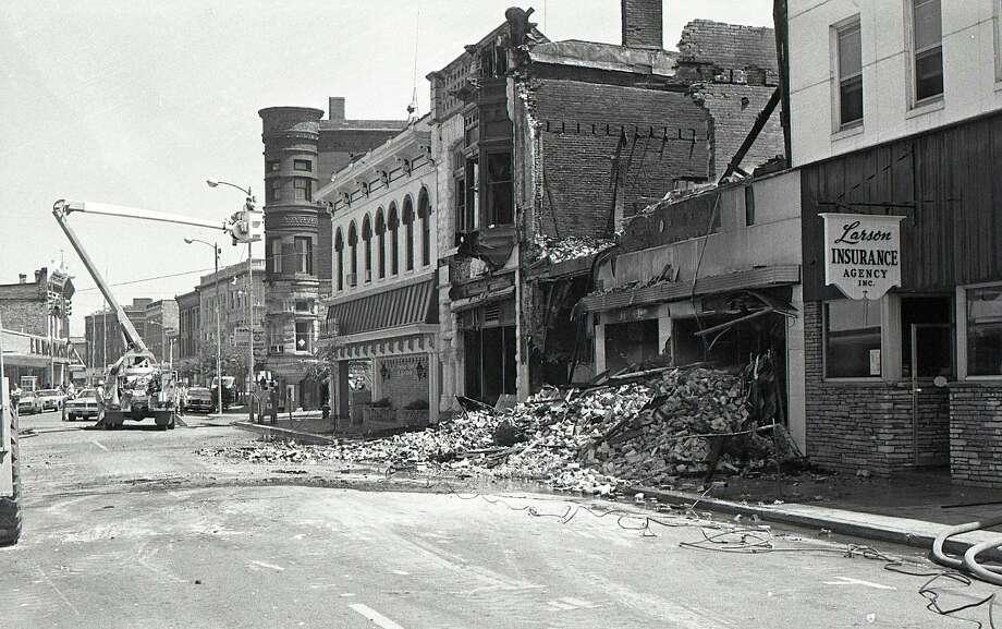 The aftermath of the fire that destroyed the Town and Country Furniture Store on River Street in 1977.