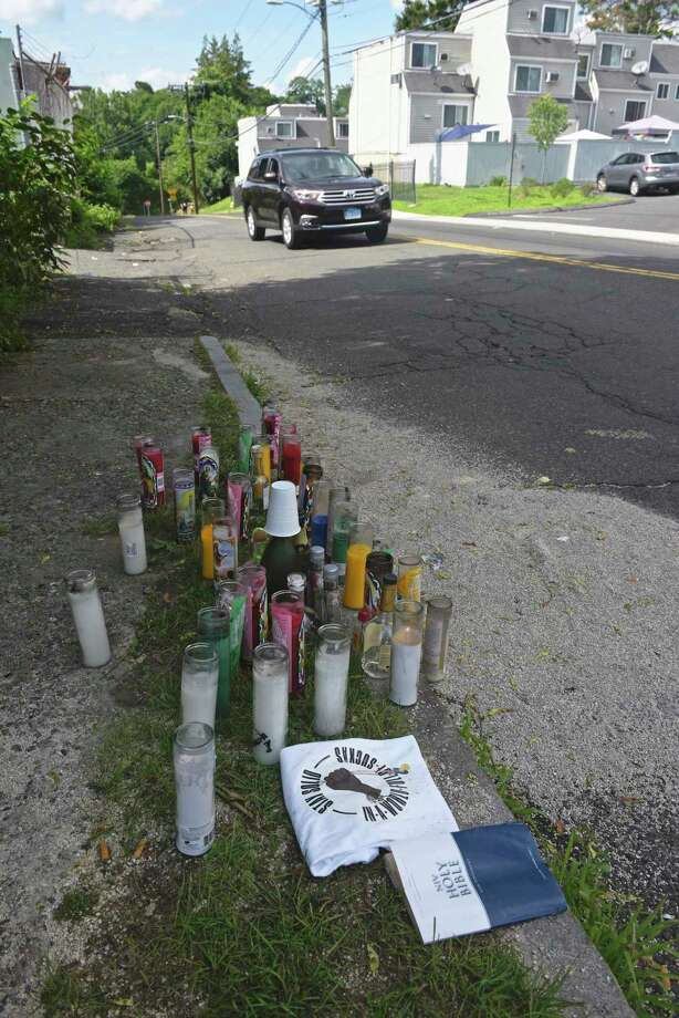 A memorial at the scene of Sunday's fatal shooting on Beaver Street. Wednesday, July 15, 2020, in Danbury, Conn. Photo: H John Voorhees III / Hearst Connecticut Media / The News-Times