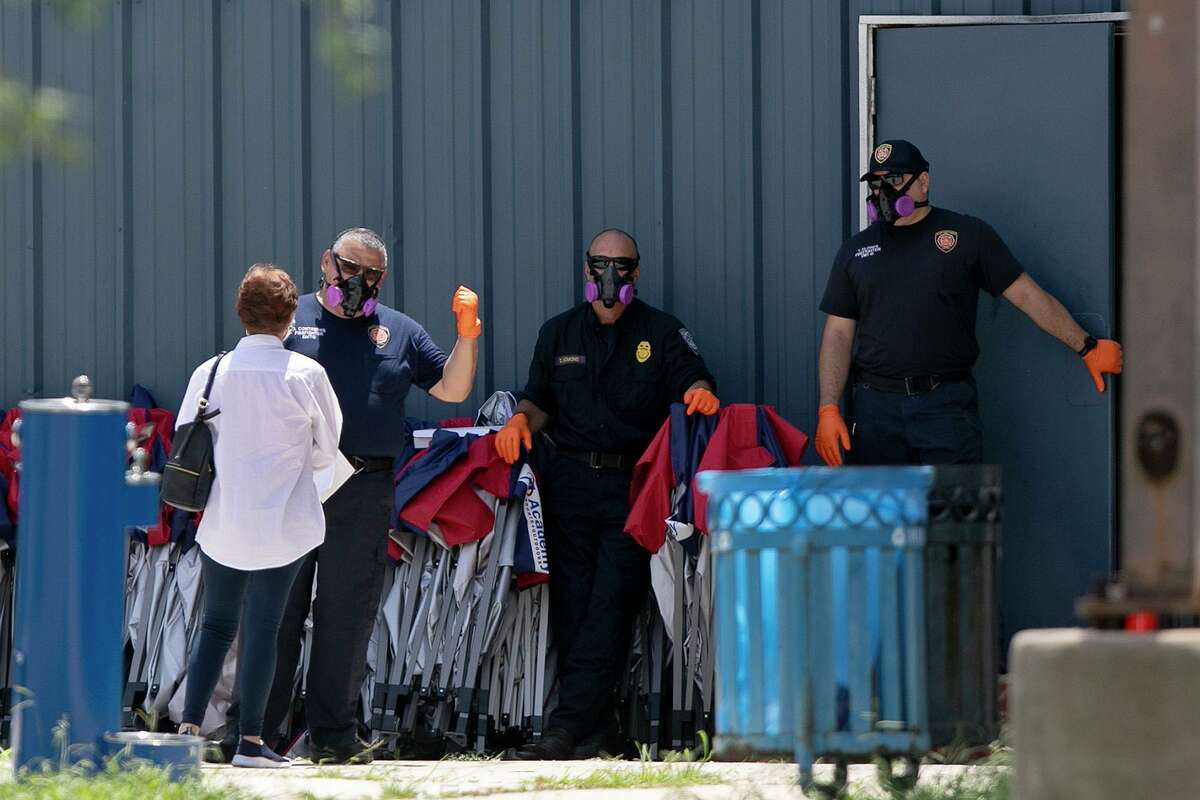 San Antonio firefighters work the entrance at a Metro Health COVID-19 walk-up testing site at the Cuellar Community Center.