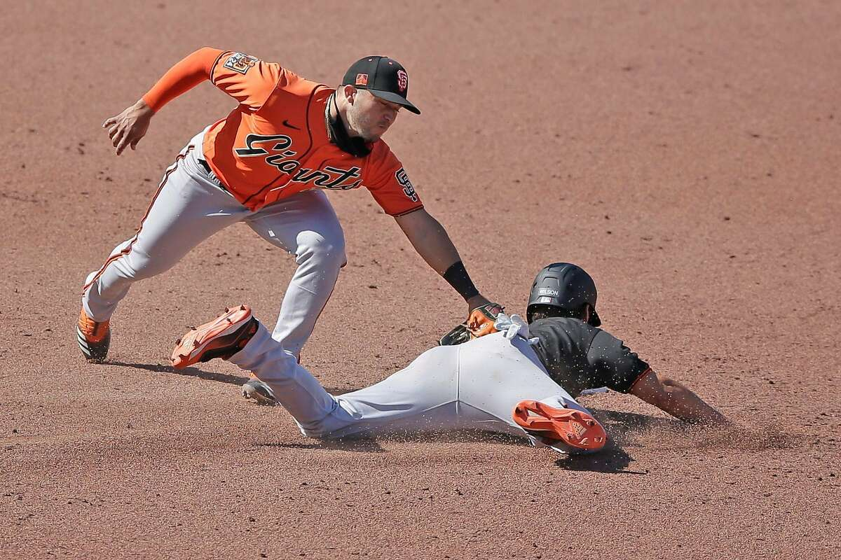 San Francisco Giants Will Wilson slides safe at second base against the Giants� Yolmer Sanchez in an intrasquad baseball game during summer camp at Oracle Park on Thursday, July 16, 2020, in San Francisco, Calif.
