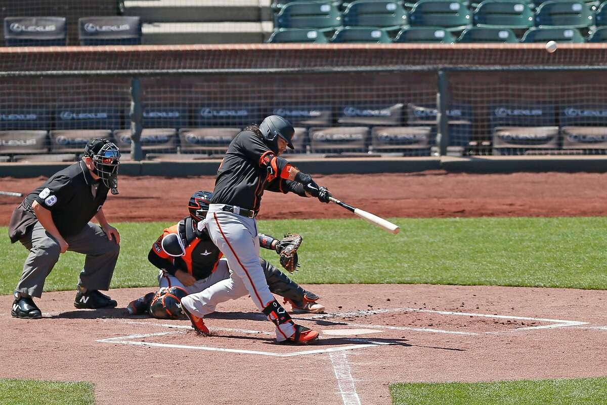 San Francisco Giants Brandon Crawford makes contact with the ball in an intrasquad baseball game during summer camp at Oracle Park on Thursday, July 16, 2020, in San Francisco, Calif.