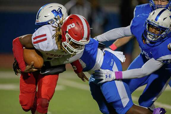 Crosby Cougars OLB Jamauri Johnson (11) is sacked by Barbers Hill Eagle DL Josh King-Bradley (48) during an UIL 5A high school football game at the Barbers Hill Eagle Stadium, Friday, October 25, 2019, in Rosenberg. Barbers Hill Eagle defeated Crosby Cougars 28-7 (Juan DeLeon/Contributor)