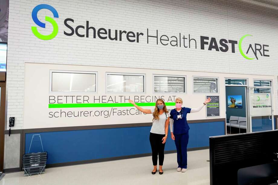 Nurse practitioners Erika Mroz and Kristie Smith stand outside Scheurer Health FastCare in celebration of its opening along with the Bad Axe Meijer. (Scheurer Hospital/Courtesy Photo)