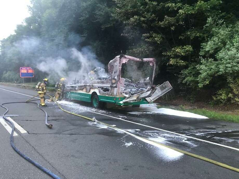 Shelton fire crews battled a vehicle fire on Route 8 on July 17 that temporarily closed the northbound area of the roadway between exits 12 and 13. Photo: Shelton Fire Department / Contributed Photo / Connecticut Post