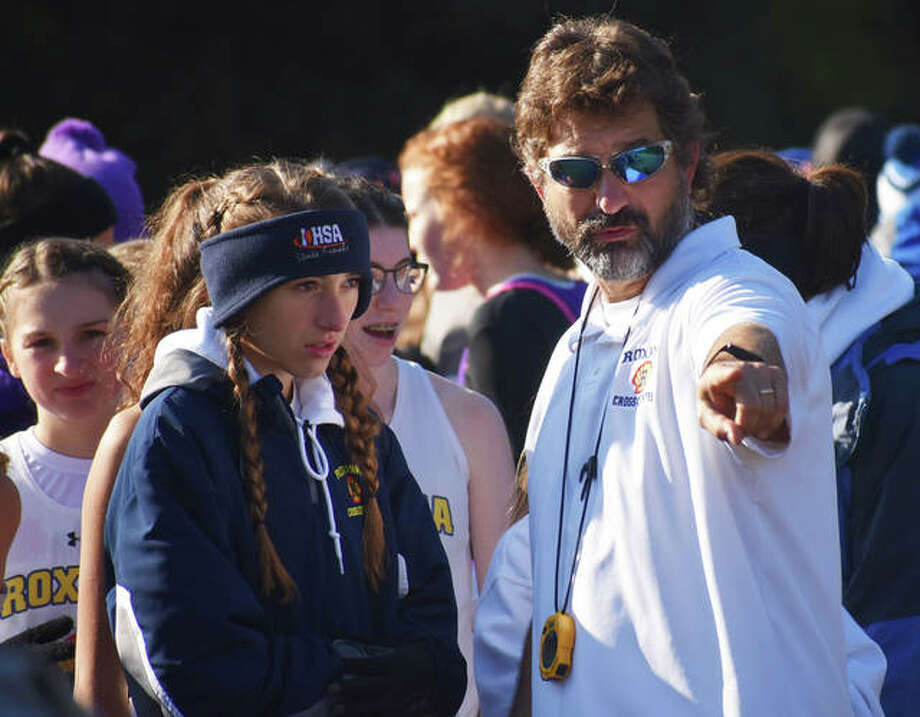 Roxana coach Scott Edwards (right) talks with Shells junior Janelynn Wirth before last season's Benton Class 1A Sectional. Edwards is the 2019 Telegraph Small-Schools Girls Cross Country Coach of the Year. Photo: Greg Shashack | The Telegraph